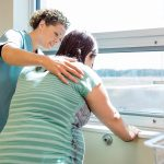 midwife comforts laboring woman